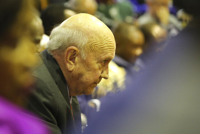 FILE — In this Feb. 13, 2020 file photo, former South African President FW de Klerk waits for President Cyril Ramaphosa to deliver his State of the Nation Address in Cape Town, South Africa. De Klerk on Monday Feb. 17 apologized and withdrew his statement that the country's former harsh system of racial separation known as apartheid was not a crime against humanity. (Sumaya Hisham /Pool Photo via AP/File)