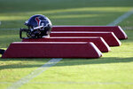 FILE - In this Aug. 3, 2010, file photo, a Houston Texans helmet sits on pads during NFL football training camp in Houston. As teams adhere to the medical protocols that wisely and necessarily have been ordered by the league and the players' union, any sort of football action might be delayed until mid-August. (AP Photo/David J. Phillip, File)