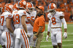 Clemson coach Dabo Swinney talks to his players against Syracuse during the first half of an NCAA college football game Saturday, Sept. 14, 2019, in Syracuse, N.Y. (AP Photo/Steve Jacobs)