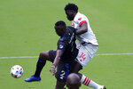 CF Montreal midfielder Victor Wanyama (2) and Toronto FC midfielder Noble Okello (14) vie for the ball during the first half of an MLS soccer match, Saturday, April 17, 2021, in Fort Lauderdale, Fla. (AP Photo/Lynne Sladky)