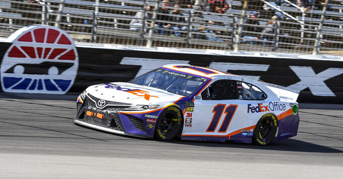 Driver Denny Hamlin races down the front stretch during a NASCAR Cup auto race at Texas Motor Speedway, Sunday, March 31, 2019, in Fort Worth, Texas. Hamlin would win the race. (AP Photo/Larry Papke)