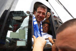 Ekrem Imamoglu, candidate of the secular opposition Republican People's Party, or CHP, reaches out from his campaign bus to shake hands with supporters following a rally in Istanbul, Friday, June 21, 2019, ahead of June 23 re-run of Istanbul elections.The 49-year-old candidate won the March 31 local elections with a slim majority, but after weeks of recounting requested by the ruling party, Turkey's electoral authority annulled the result of the vote, revoked his mandate and ordered the new election.(AP Photo/Lefteris Pitarakis)