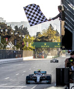 Mercedes driver Valtteri Bottas of Finland crosses the finish line to win the Formula One Grand Prix at the Baku Formula One city circuit in Baku, Azerbaijan, Sunday, April 28, 2019. (Srdjan Suki/Pool Photo via AP)