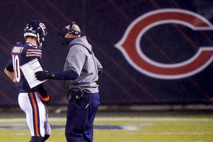 Chicago Bears head coach Matt Nagy talks to quarterback Mitchell Trubisky during the first half of an NFL football game against the Green Bay Packers Sunday, Jan. 3, 2021, in Chicago. (AP Photo/Nam Y. Huh)