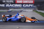 Scott Dixon, of New Zealand, steers his car during a practice session for an IndyCar auto race at Indianapolis Motor Speedway, Thursday, Oct. 1, 2020, in Indianapolis. (AP Photo/Darron Cummings)