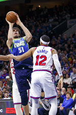 Dallas Mavericks' Boban Marjanovic, left, shoots against Philadelphia 76ers' Tobias Harris, right, during the first half of an NBA basketball game, Friday, Dec. 20, 2019, in Philadelphia. (AP Photo/Chris Szagola)