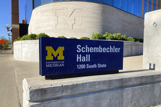Schembechler Hall on the University of Michigan Campus in Ann Arbor, Mich. is shown Wednesday, May 12, 2021. The building is named after the school's legendary football coach Bo Shembechler. A report released Tuesday, May 11, 2021, about the stunning lack of action at the University of Michigan while a rogue doctor, Robert Anderson, was sexually assaulting hundreds of young men has pointed an unflattering light at one of the school's giants, the late football coach Bo Schembechler, whose bronze statue stands on campus.(AP Photo/Mike Householder)