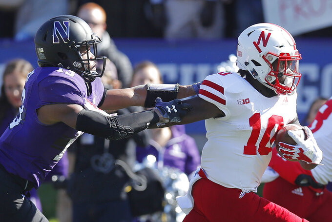 Nebraska's JD Spielman, right, pushes off Northwestern's JR Pace on his way to scoring a touchdown iin the first half of an NCAA college football game Saturday, Oct. 13, 2018, in Evanston, Ill.. (AP Photo/Jim Young)