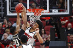 Louisville forward Jordan Nwora (33) blocks the shot of Wake Forest forward Ody Oguama (33) during the first half of an NCAA college basketball game Wednesday, Feb. 5, 2020, in Louisville, Ky. (AP Photo/Wade Payne)