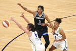 Chicago Sky's Candace Parker (3) passes the ball past Minnesota Lynx's Bridget Carleton (6) during the first half of a WNBA basketball game Tuesday, June 15, 2021, in Minneapolis. (AP Photo/Stacy Bengs)