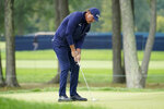 Phil Mickelson, of the United States, putts on the second green during the second round of the US Open Golf Championship, Friday, Sept. 18, 2020, in Mamaroneck, N.Y. (AP Photo/John Minchillo)