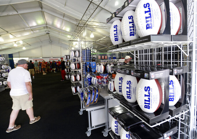 FILE - In this July 27, 2017, file photo, fans shop in the merchandise tent on opening day of Buffalo Bills  NFL football training camp in Pittsford, N.Y. The Mafia is becoming legitimate in Buffalo — the Bills Mafia that is. The Bills last week filed an application to trademark its fanbase's adopted nickname in preparation to launch a series of branded merchandise and apparel available at its team store and sold online. (AP Photo/Adrian Kraus, File)
