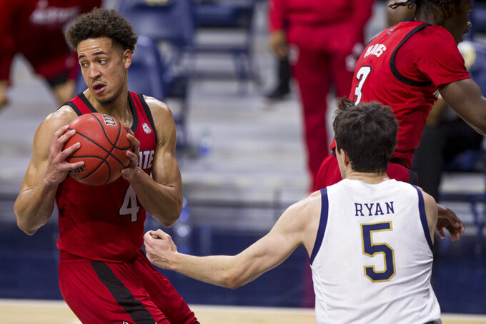 North Carolina State's Jericole Hellems (4) grabs a rebound next to Notre Dame's Cormac Ryan (5) during the first half of an NCAA college basketball game Wednesday, March 3, 2021, in South Bend, Ind. North Carolina State won 80-69. (AP Photo/Robert Franklin)