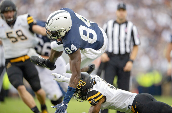 Appalachian State defensive back Clifton Duck trips up Penn State wide receiver Juwan Johnson after a reception during an NCAA college football game Saturday, Sept. 1, 2018, in State College, Pa. (Abby Drey/Centre Daily Times via AP)