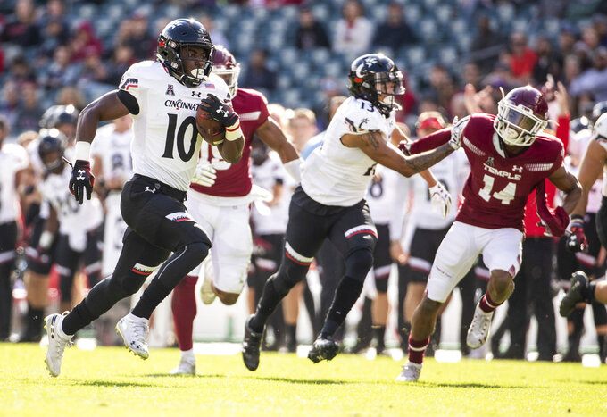 Cincinnati's running back Charles McClelland (10) runs the ball in for a touchdown during the second half of an NCAA college football against Temple, Saturday, Oct. 20, 2018, in Philadelphia. Temple won 24-17 in overtime. (AP Photo/Chris Szagola)