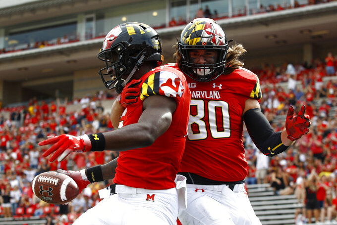 Maryland tight end Chigoziem Okonkwo, left, celebrates his touchdown with Noah Barnes in the second half of an NCAA college football game against Minnesota, Saturday, Sept. 22, 2018, in College Park, Md. Maryland won 42-13. (AP Photo/Patrick Semansky)
