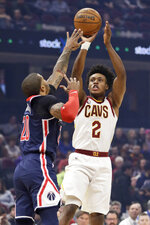 Cleveland Cavaliers' Collin Sexton (2) shoots over Washington Wizards' Gary Payton II (20) in the first half of an NBA basketball game, Thursday, Jan. 23, 2020, in Cleveland. (AP Photo/Tony Dejak)