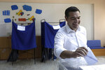 Greek Prime Minister and Syriza party leader Alexis Tsipras casts his ballot at a polling station in Athens, on Sunday, July 7, 2019. Greeks are voting in the first parliamentary election since their country emerged from three successive international bailouts but is still struggling to emerge from a crippling nearly decade-long financial crisis. (AP Photo/Yorgos Karahalis)