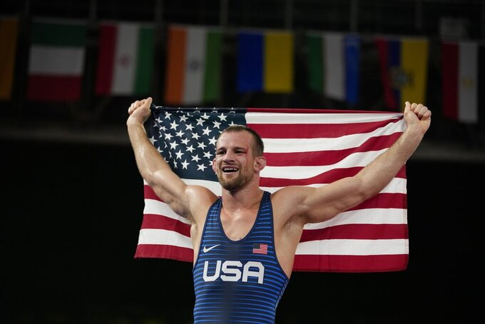 United States' David Morris Taylor III celebrates holding the US flag after winning the gold medal in the men's 86kg Freestyle wrestling event at the 2020 Summer Olympics, Thursday, Aug. 5, 2021, in Tokyo, Japan. (AP Photo/Aaron Favila)