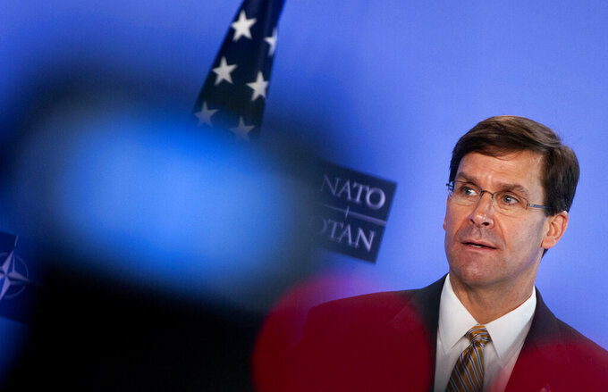 U.S. Secretary of Defense Mark Esper speaks during a joint press conference with NATO Secretary General Jens Stoltenberg at NATO headquarters in Brussels, Friday, June 26, 2020. U.S. Secretary of Defense Mark Esper is at NATO to meet with NATO Secretary General Jens Stoltenberg and to follow-up on a broad range of issues raised during last week's NATO defense ministerial. (AP Photo/Virginia Mayo, Pool)