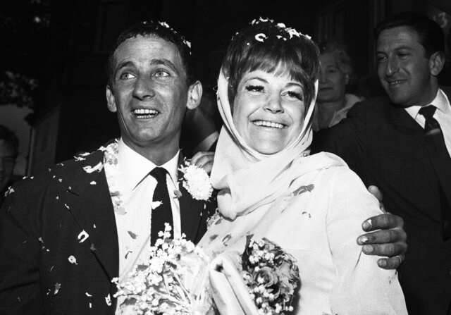 FILE - In this Aug. 19, 1963, file photo, British jazz singer Annie Ross, right, and actor Sean Lynch are covered with confetti after their marriage in London. Ross, who rose to fame as a jazz singer in the 1950s, struggled with personal problems in the '60s, faded from the spotlight in the '70s, re-emerged as a successful character actress in the '80s and finished her career as a cabaret mainstay, died Tuesday, July 21, 2020, at her home in New York. She was 89. Her death was confirmed by her former manager, Jim Coleman. (AP Photo/Dear, File)