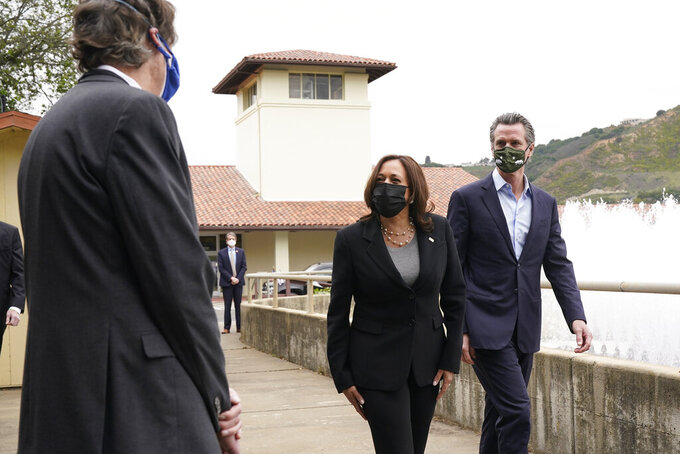 FILE - In this April 5, 2021, file photo, Vice President Kamala Harris, left, and California Gov. Gavin Newsom visit the Upper San Leandro Water Treatment Plant in Oakland, Calif. The California Democratic Party is gathering for its annual convention on the heels of a recall against Gov. Gavin Newsom reaching the signature threshold to qualify for the ballot. Newsom is set to address the party faithful Saturday, May 1, alongside other big names like Vice President Kamala Harris. (AP Photo/Jacquelyn Martin, File)