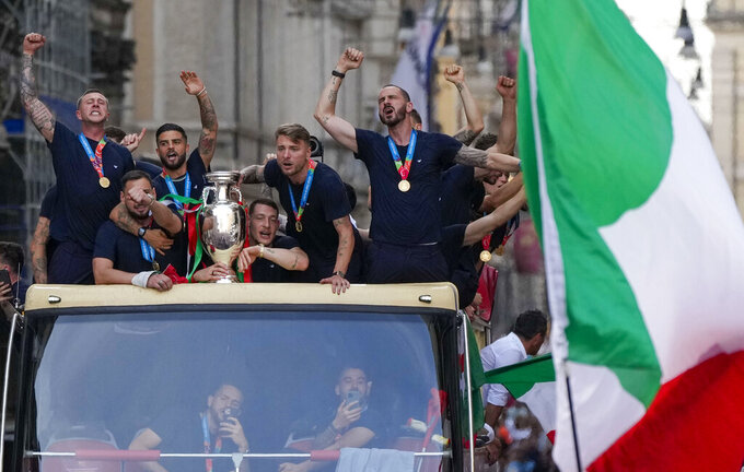 Italy's players celebrate in Rome, Monday, July 12, 2021, their victory of the Euro 2020 soccer championships in a final played at Wembley stadium in London on Sunday. Italy beat England 3-2 in a penalty shootout after a 1-1 draw. (AP Photo/Alessandra Tarantino)