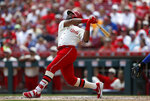 Cincinnati Reds' Phillip Ervin follows through on an RBI-single off Chicago Cubs starting pitcher Jon Lester during the sixth inning of a baseball game, Sunday, June 30, 2019, in Cincinnati. (AP Photo/Gary Landers)