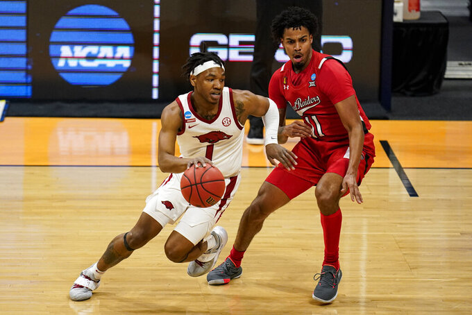 Arkansas guard JD Notae (1) drives on Texas Tech guard Kyler Edwards (11) in the first half of a second-round game in the NCAA men's college basketball tournament at Hinkle Fieldhouse in Indianapolis, Sunday, March 21, 2021. (AP Photo/Michael Conroy)