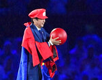 "FILE - In this Aug. 21, 2016, file photo, Japanese Prime Minister Shinzo Abe appears as the Nintendo game character Super Mario during the closing ceremony at the 2016 Summer Olympics in Rio de Janeiro, Brazil. Prime Minister Abe might be the biggest loser if the Tokyo Olympics don't go off as planned in just over four months. Abe has attached himself to the success of the Olympics since pushing hard for Tokyo's selection at an IOC meeting in 2013 in Buenos Aires, Argentina. Tokyo was picked over Istanbul by billing itself as a ""safe pair of hands.""  (Yu Nakajima/Kyodo News via AP, File)"
