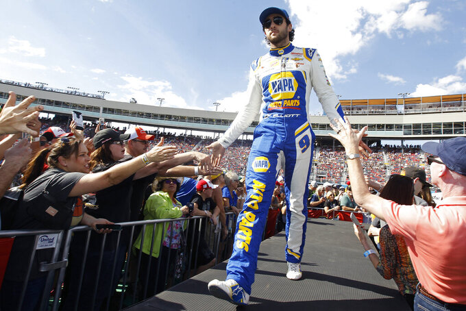 Chase Elliott greets fans during driver introductions prior to the NASCAR Cup Series auto race at ISM Raceway, Sunday, Nov. 10, 2019, in Avondale, Ariz. (AP Photo/Ralph Freso)