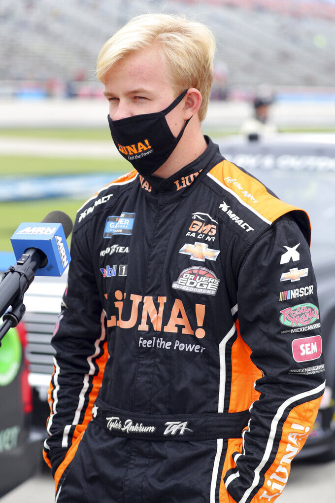 NASCAR Texas Trucks Series driver Tyler Ankrum (26) stands on pit road before a NASCAR Cup Series auto race at Texas Motor Speedway in Fort Worth, Texas, Sunday, Oct. 25, 2020. (AP Photo/Richard W. Rodriguez)