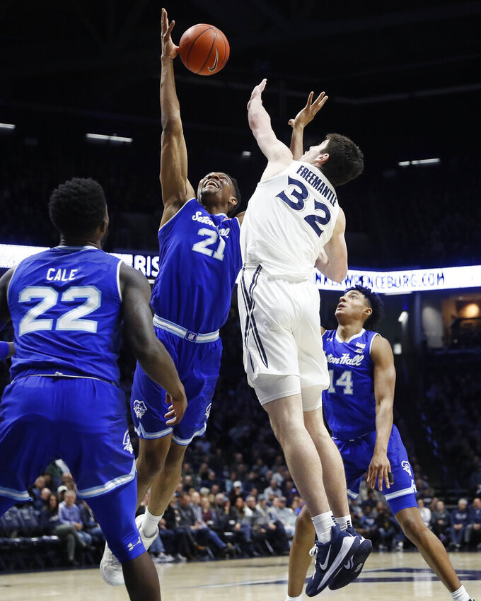 Seton Hall's Ike Obiagu (21) and Xavier's Zach Freemantle (32) battle for a rebound during the first half of an NCAA college basketball game, Wednesday, Jan. 8, 2020, in Cincinnati. (AP Photo/John Minchillo)
