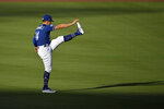 Los Angeles Dodgers left fielder Enrique Hernandez warms up during the restart of baseball spring training Monday, July 6, 2020, in Los Angeles. (AP Photo/Mark J. Terrill)