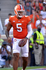 Clemson quarterback D. J. Uiagalelei (5) celebrates a touchdown in the first half of an NCAA college football game against South Carolina State on Saturday, Sept. 11, 2021, in Clemson, S.C. (AP Photo/Edward M. Pio Roda)