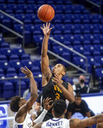 Norfolk State guard Mustafa Lawrence (3) goes up for a shot over James Madison guard Matt Lewis (1) during the first half of an NCAA basketball game in Harrisonburg, Va., Friday, Nov. 27, 2020. (Daniel Lin/Daily News-Record via AP)