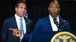 Brooklyn Borough President and New York City mayoral candidate Eric Adams, right, speaks to the media accompanied by Gov. Andrew Cuomo during a news conference at Lenox Road Baptist Church in the Brooklyn borough of New York on Wednesday, July 14, 2021. (AP Photo/Eduardo Munoz Alvarez)