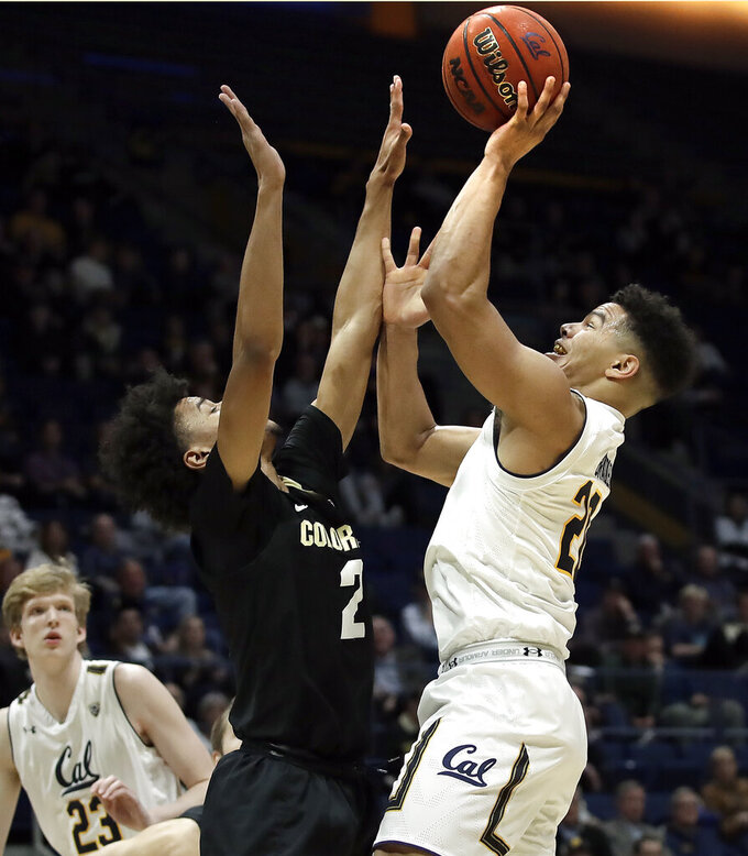 California's Matt Bradley, right, shoots over Colorado's Daylen Kountz (2) in the first half of an NCAA college basketball game Thursday, Jan. 24, 2019, in Berkeley, Calif. (AP Photo/Ben Margot)