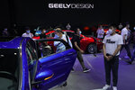 Visitors look at cars produced by Geely at the Auto China 2020 show in Beijing on Sunday, Sept. 27, 2020. Chinese automaker Geely said Monday, Jan. 11, 2021, it will form an electric car venture with tech giant Baidu, adding to a flurry of corporate tie-ups in the industry to share soaring technology development costs. (AP Photo/Ng Han Guan)