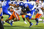 Kentucky running back Asim Rose, front right, is hit by Florida linebacker David Reese II (33) during the second half of an NCAA college football game in Lexington, Ky., Saturday, Sept. 14, 2019. (AP Photo/Timothy D. Easley)