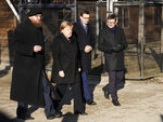 Museum director Piotr Cywinski, German Chancellor Angela Merkel, Polish Prime Minister Mateusz Morawiecki and deputy director Andrzej Kacorzyk, from left, visit the former Nazi death camp of Auschwitz-Birkenau in Oswiecim, Poland on Friday, Friday, Dec. 6, 2019. Merkel attend an event in occasion of the 10th anniversary of the founding of the Auschwitz Foundation. (AP Photo/Czarek Sokolowski)