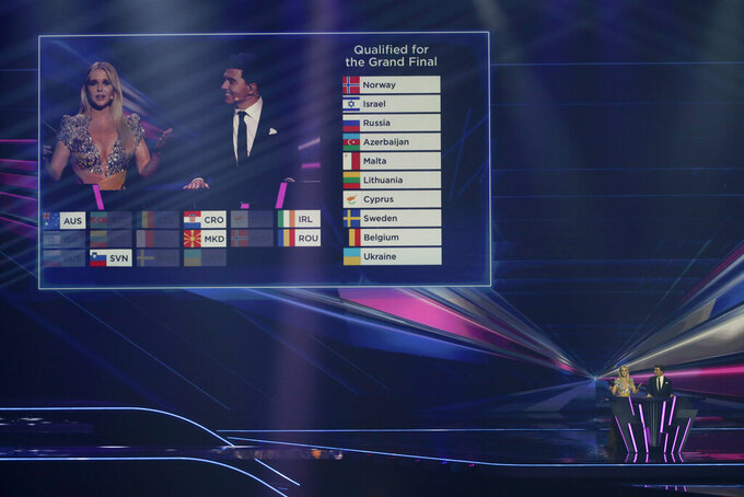 The 10 qualifying countries are announced during the first semifinal of the Eurovision Song Contest at Ahoy arena in Rotterdam, Netherlands, Tuesday, May 18, 2021. (AP Photo/Peter Dejong)