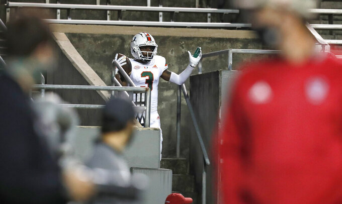 Miami wide receiver Mike Harley (3) celebrates after running into the stands following a 20-yard touchdown reception against North Carolina State during the first half of an NCAA college football game Friday, Nov. 6, 2020, in Raleigh, N.C. (Ethan Hyman/The News & Observer via AP, Pool)