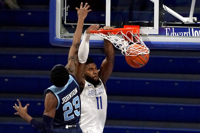 Saint Louis' Hasahn French (11) dunks as Rhode Island's D.J. Johnson (23) defends during the first half of an NCAA college basketball game Wednesday, Feb. 10, 2021, in St. Louis. (AP Photo/Jeff Roberson)