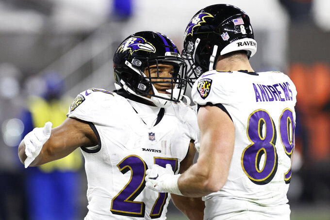 Baltimore Ravens running back J.K. Dobbins (27) celebrates with tight end Mark Andrews (89) after Dobbins scored a one-yard touchdown during the second half of an NFL football game against the Cleveland Browns, Monday, Dec. 14, 2020, in Cleveland. (AP Photo/Ron Schwane)