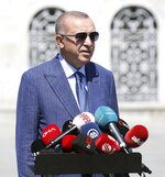 Turkey's President Recep Tayyip Erdogan speaks to supporters and the media after Friday prayers in Hagia Sophia, in Istanbul, Friday, Aug. 7, 2020. Erdogan joined worshipers on July 24 for the first Muslim prayers in 86 years inside the Istanbul landmark that served as one of Christendom's most significant cathedrals, a mosque and a museum before its conversion back into a Muslim place of worship.Turkey's president has called a maritime deal between Greece and Egypt