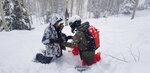 In this Saturday, Jan. 11, 2020 photo, professional backcountry skier Jackie Paaso, right, examines the transceiver of student Kayla Arft, 25, of Salt Lake City during an all-women avalanche clinic at Solitude Mountain Resort in Solitude, Utah. Pro backcountry skiers Michelle Parker, Elyse Saugstad, Ingrid Backstrom, Paaso, Lel Tone and Reine Barkered sold out both days of the all-day SAFE AS clinics over the weekend. It was the first time they had brought the clinics to Utah since 2013. (Julie Jag/The Salt Lake Tribune via AP)