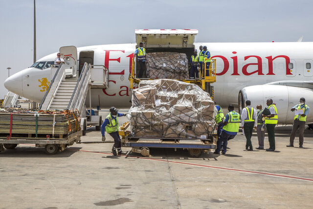 In this photo released by Xinhua News Agency, workers unload donations from Jack Ma Foundation and Alibaba Foundation at the Blaise Diagne International Airport in Dakar, Senegal, on Saturday, March 28, 2020. As the coronavirus spread, the world's richest communist dug into his deep pockets. Jack Ma, founder of e-commerce giant Alibaba Group and a member of the ruling Communist Party, helped to pay for 1,000 ventilators delivered to New York in April. Ma's foundation also is giving ventilators, masks and other supplies in Africa, Latin America and Asia.(Eddy Peters/Xinhua via AP)