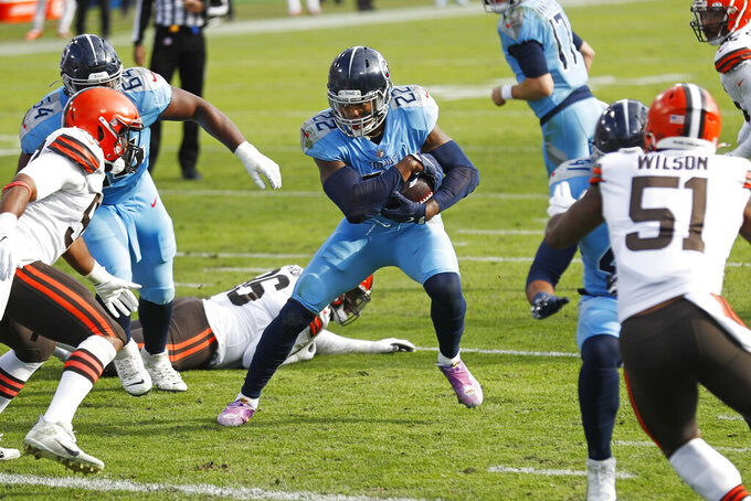 Tennessee Titans running back Derrick Henry (22) carries the ball against the Cleveland Browns in the second half of an NFL football game Sunday, Dec. 6, 2020, in Nashville, Tenn. (AP Photo/Wade Payne)