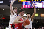 Gonzaga forward Drew Timme, left, and guard Ryan Woolridge, right, double-team Loyola Marymount guard Lazar Zivanovic during the second half of an NCAA college basketball game in Spokane, Wash., Thursday, Feb. 6, 2020. Gonzaga won 85-67. (AP Photo/Young Kwak)
